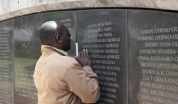 Douglas Sidialo, who lost his sight in the 1998 bombing of the U.S. embassy in Nairobi pray at the memorial remembering the victims in Nairobi, Kenya, Monday, May 2. 2011. Bin Laden, the glowering mastermind behind the Sept. 11, 2001, terror attacks that killed thousands of people, was slain in his hideout in Pakistan early Monday in a firefight with U.S. forces, ending a manhunt that spanned a frustrating decade. (AP Photo/Khalil Senosi)