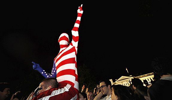 "A man who said he was dressed as ""Captain America,"" cheers early Monday, May 2, 20111, across the street from the White House in Washington, as people gather to cheer the United States after it was announced that Osama bin Laden has been killed. (AP Photo/Jacquelyn Martin)"