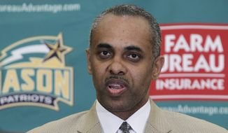 **FILE** Paul Hewitt, the newly-named basketball coach at George Mason University, speaks during a news conference in Fairfax, Va., on May 2, 2011. (Associated Press)