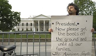 Danny Montoya of Warrenton, Va., holds a sign up in Lafayette Park outside the White House on May 2, 2011, the morning after the country learned that Osama Bin Laden had been killed by U.S. Navy Seals. Montoya says that our first initiative following the Sept. 11 attacks was to get Osama Bin Laden, and he feels that now that he's dead, some of the U.S. troops who have been assigned to more remote areas of Afghanistan and Pakistan should be able to come home. (Barbara L. Salisbury/The Washington Times)