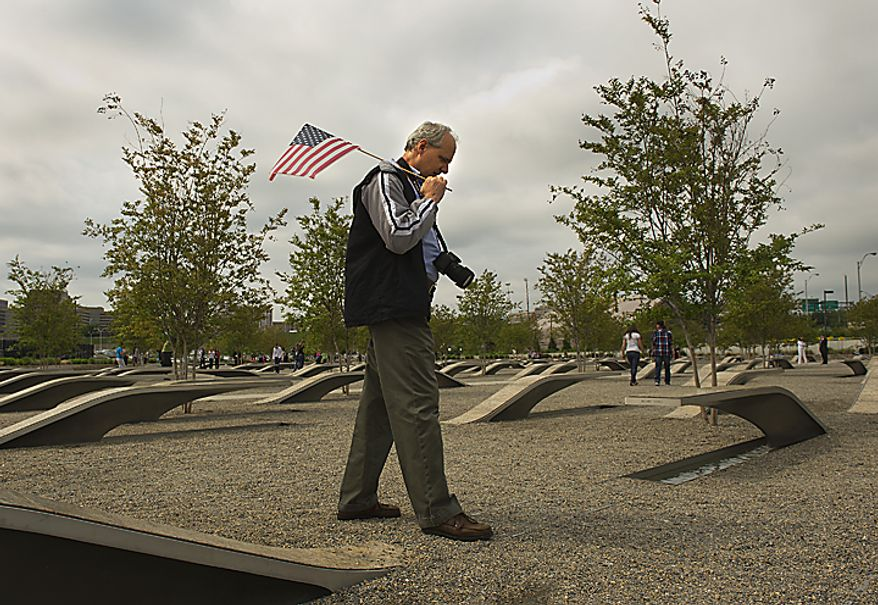 """""""I think it's just,"""" said Olney, Md., resident Stuart Showalter of Osama Bin Laden's death. """"He got what he deserved. In fact, he got less than he deserved."""" Showalter said that he came to the Pentagon Memorial in Arlington, Va., on Monday, May 2, 2011, the morning after the country learned that Osama Bin Laden had been killed by U.S. Navy Seals because Bin Laden was the mastermind behind the Sept. 11 attacks, and he """"wanted to come down here and remember the people who died here."""" The Pentagon Memorial is dedicated to the 184 people who were killed at the Pentagon on Sept. 11, 2001. (Barbara L. Salisbury/The Washington Times)"""