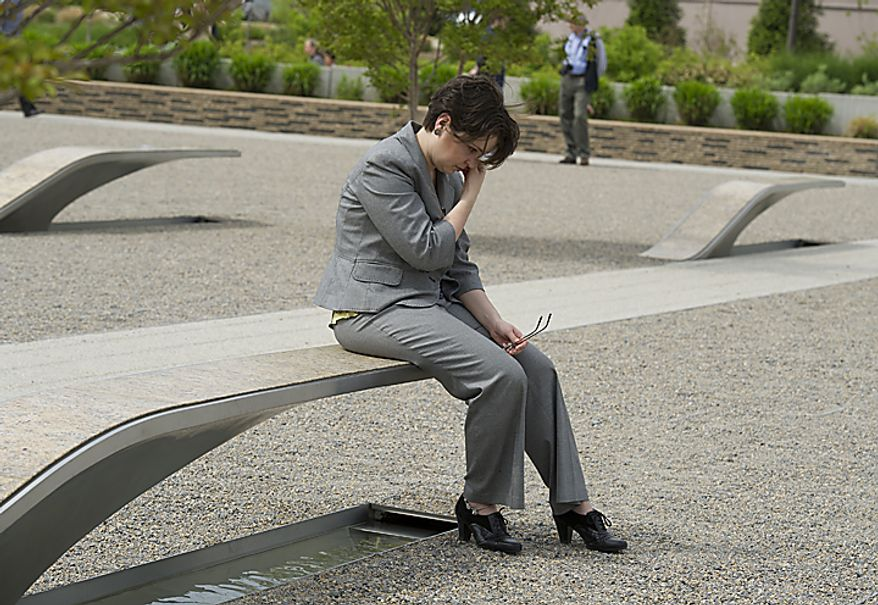 """Christy Heib of Woodbridge, Va., who works at the Pentagon, wipes her eyes while sitting on one of the benches at the Pentagon Memorial in Arlington, Va., on Monday, May 2, 2011, the morning after the country learned that Osama Bin Laden had been killed by U.S. Navy Seals. Heib says that she hasn't come out to the memorial in a while, but given the news of Bin Laden's death she wanted to come out and spend a few moments there. """"It puts it all in perspective,"""" said Heib, who credits the Sept. 11, 2001 attacks as the reason she decided to start a career in government service. (Barbara L. Salisbury/The Washington Times)"""