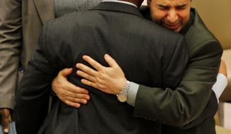 ASSOCIATED PRESS PHOTOGRAPHS Deputy U.N. Ambassador Ibrahim Dabbashi (right) hugs Libya's U.N. Ambassador Mohamed Shalgham after a meeting of the Security Council at United Nations headquarters in February. Tension was high at the time after fighting broke out between pro- and anti-Gadhafi forces.