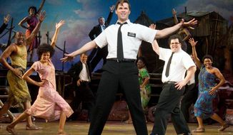 "Andrew Rannells (center) performs with an ensemble cast in ""The Book of Mormon"" at the Eugene O'Neill Theatre in New York. ""The Book of Mormon"" nabbed a leading 14 Tony Award nominations Tuesday, including nods for best musical and best original score. Associated Press"