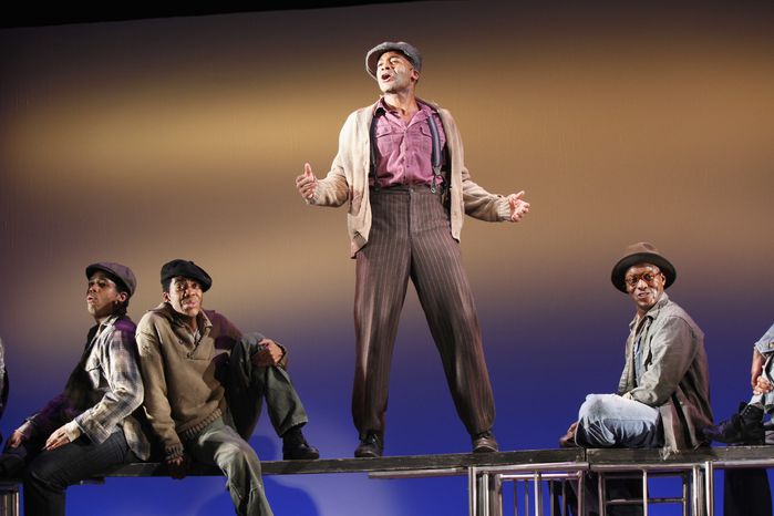 """Associated Press photographs From left, Derrick Cobey, Julius Thomas III, Brandon Victor Dixon and Josh Breckenridge perform a scene from """"The Scottsboro Boys,"""" a tale of 1930s injustice framed as a minstrel show, at off-Broadway's Vineyard Theatre in New York. It earned 12 Tony nominations."""