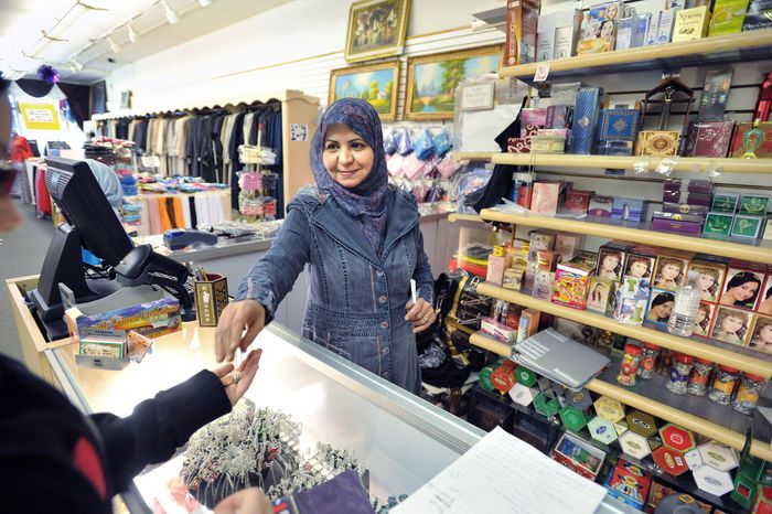 "PHOTOGRAPHS BY BRYAN MITCHELL/SPECIAL TO THE WASHINGTON TIMES ""Everybody's happy"" Osama bin Laden is dead, says Ilham Hussein, working at the Mekkah Islamic Superstore in Dearborn, Mich. ""He's given the Muslim people a bad name."" The sentiment is common in Dearborn, with the highest concentration of Arabs in North America."
