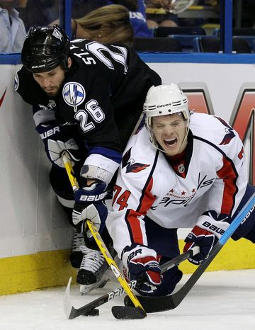 Associated press Capitals defenseman John Carlson grimaces as he battles for the puck with Lightning right wing Martin St. Louis during the second period. Tampa Bay edged Washington 4-3 for a commanding 3-0 lead in their series.