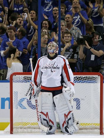 ASSOCIATED PRESS Capitals goalie Michal Neuvirth checks the scoreboard after Tampa Bay scored two goals during a span of 24 seconds to take a 4-3 lead in the third period in Game 3.