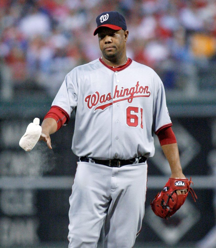 ASSOCIATED PRESS Nationals right-hander Livan Hernandez worked 6  1/3 innings, allowing four earned runs in Washington's 4-1 loss to Philadelphia on Tuesday night. He surrendered 10 hits, walked four and struck out three.
