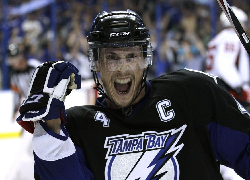 Tampa Bay Lightning center Vincent Lecavalier celebrates after goal against the Washington Capitals during the second period in Game 3 of an NHL hockey Stanley Cup playoffs Eastern Conference semifinal series Tuesday, May 3, 2011, in Tampa, Fla. (AP Photo/Chris O'Meara)