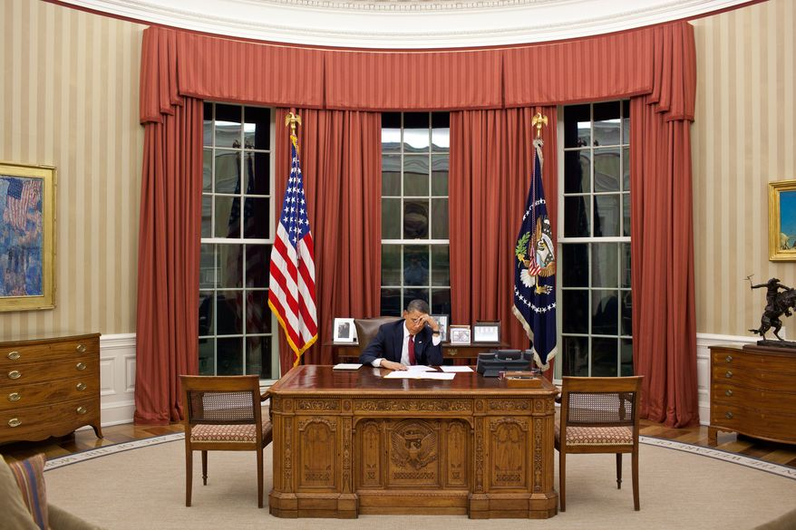 In this image released by the White House, President Barack Obama edits his speech in the Oval Office prior to making a televised statement detailing the mission against Osama bin Laden, Sunday, May 1, 2011, at the White House in Washington. (AP Photo/The White House, Pete Souza)