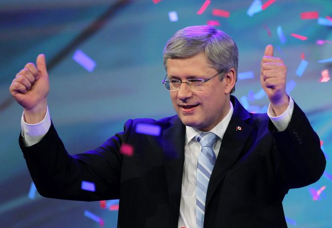 Canadian Prime Minister Stephen Harper gives the thumbs up after giving his victory speech in Calgary, Alberta, on Monday, May 2, 2011, after his Conservatives won a coveted majority government in parliamentary elections. (AP Photo/Canadian Press/Adrian Wyld)