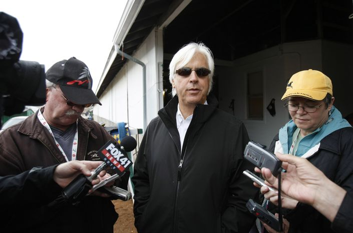 Trainer Bob Baffert talks with reporters at his barn in the stable area of Churchill Downs Monday, May 2, 2011, in Louisville, Ky. Baffert trains Kentucky Derby hopeful Midnight Interlude. (AP Photo/Ed Reinke)