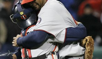 Minnesota Twins starting pitcher Francisco Liriano, right, celebrates with catcher Drew Butera after his no-hitter and 1-0 win over Chicago White Sox in a baseball game Tuesday, May 3, 2011 in Chicago. (AP Photo/Charles Rex Arbogast)