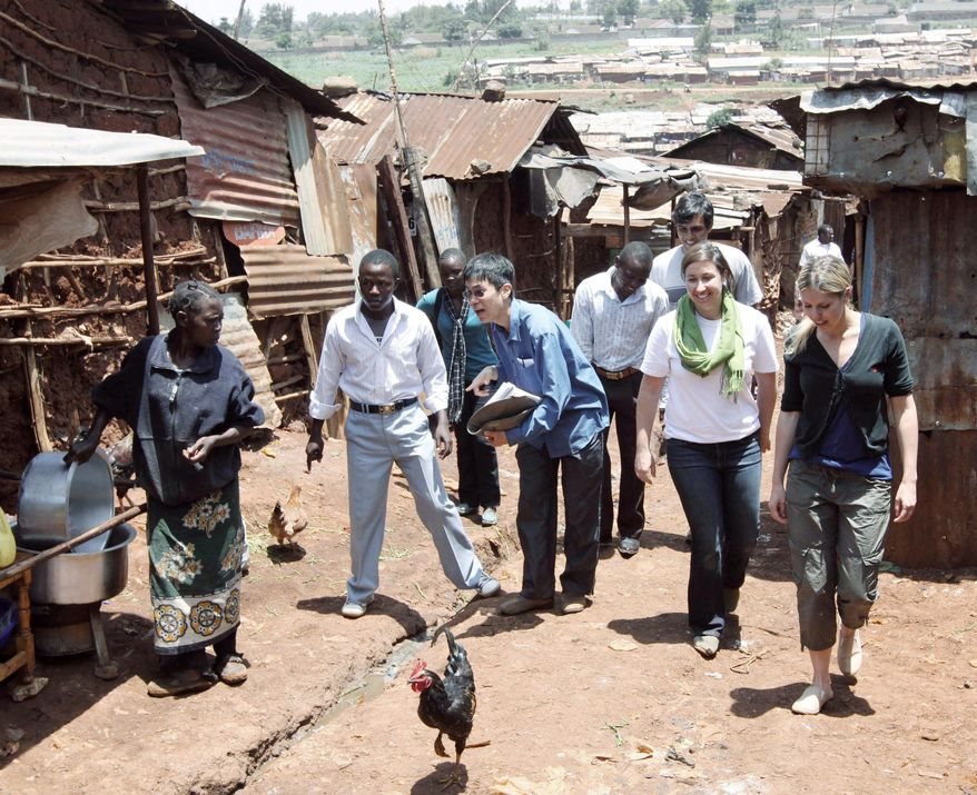 Associated Press photographs Four MIT grad students walk through a Nairobi, Kenya, slum in late March seeking answers about the usage of a nearby U.S.-funded medical clinic.