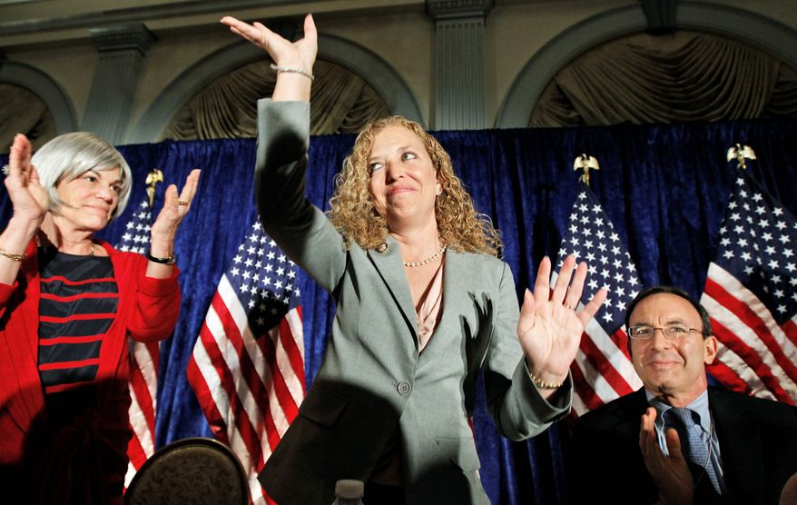 Associated Press Rep. Debbie Wasserman Schultz, Florida Democrat, acknowledges the crowd at a meeting of the Democratic National Committee on Wednesday in Washington, at which she was elected DNC chairwoman. Mrs. Wasserman Schultz was handpicked by President Obama.