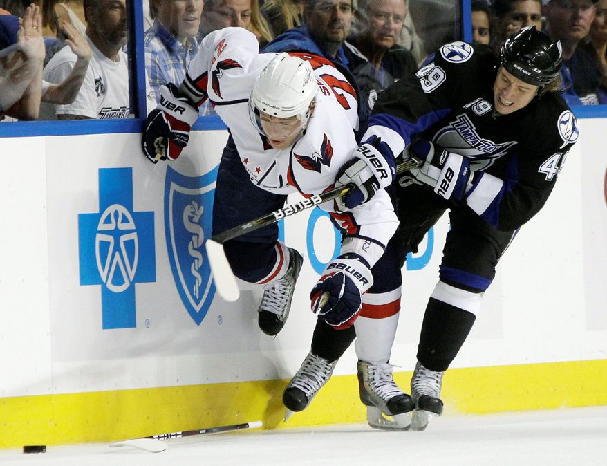 Associated press Capitals left wing Alexander Semin (left) tries to muscle past Tampa Bay center Blair Jones for a loose puck during the first period in Game 4. The Capitals had lost the first three games of the Eastern Conference semifinal series.