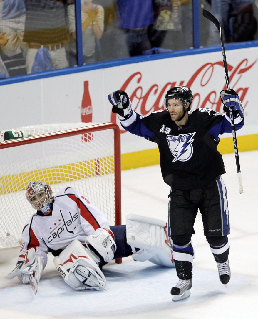 ASSOCIATED PRESS Tampa Bay's Dominic Moore celebrates a goal by Sean Bergenheim (not pictured) in front of Washington goalie Michal Neuvirth during the Lightning's 5-3, series-clinching victory in Game 4.