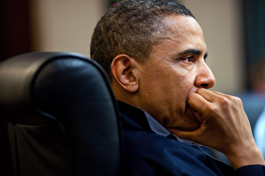 In this image released by the White House, President Obama listens during one in a series of meetings discussing the mission against Osama bin Laden, in the Situation Room of the White House on Sunday. (Associated Press)