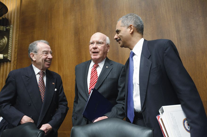 Sen. Patrick J. Leahy (center), Vermont Democrat, and Sen. Charles E. Grassley (left), Iowa Republican, welcome Attorney General Eric H. Holder Jr. on Capitol Hill in Washington on Wednesday, May 4, 2011, before Mr. Holder testifies before the Senate Judiciary Committee. (AP Photo/J. Scott Applewhite)