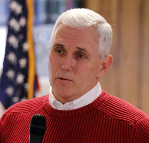 **FILE** Rep. Mike Pence, Indiana Republican, meets Jan. 28 with constituents in Pendleton, Ind. Pence is planning a private conference call with supporters this week, fueling speculation that he will make an announcement soon on whether he'll run for Indiana governor in 2012. (Associated Press)