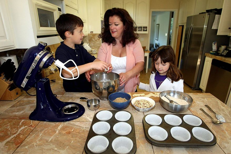 In this May 5, 2011 file photo, Angel La Liberte bakes muffins with her children Leo and Isabella at their California home. As Mother's Day approaches, Mrs. La Liberte and others are launching an online campaign to build support for older mothers. (Special to The Washington Times/Dan Coyro)