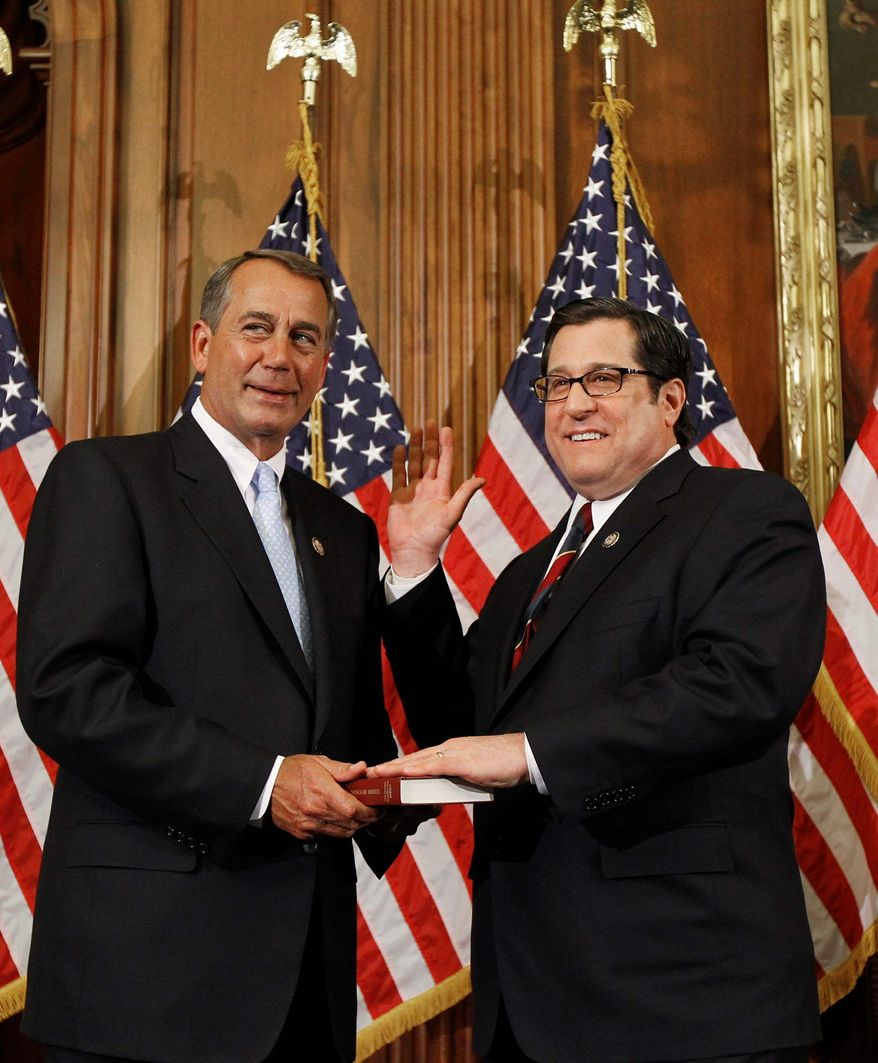House Speaker John Boehner of Ohio, left, participates in a ceremonial House swearing-in ceremony for Rep. Steve Rothman, D-N.J., on Capitol Hill in Washington Wednesday, Jan. 5, 2011.(AP Photo/Alex Brandon)