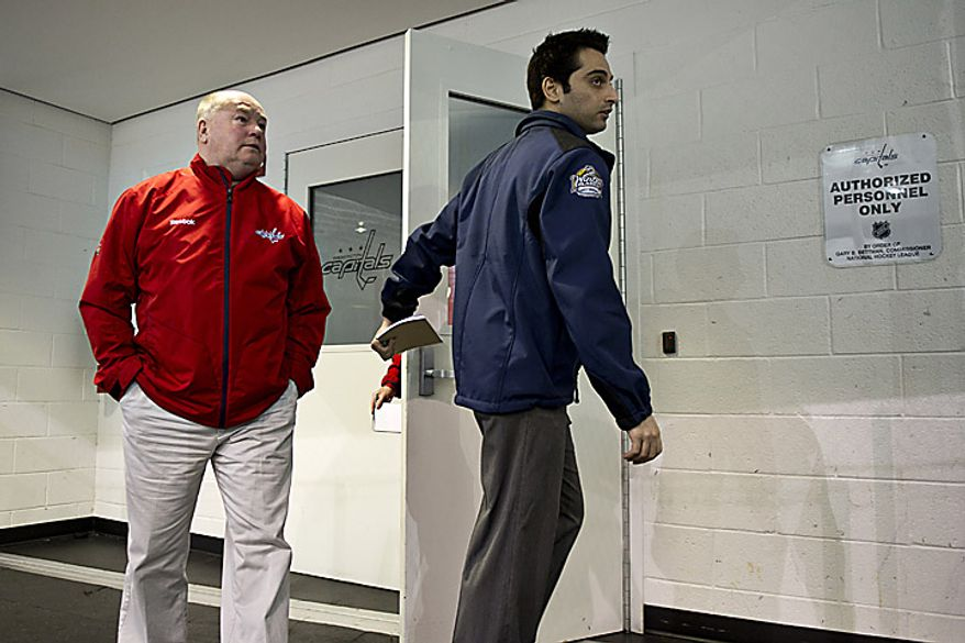 Capitals coach Bruce Boudreau emerges from the locker room on his way to talk to the media at the Kettler Ice Complex in Arlington on Thursday, May 5, 2011. (Drew Angerer/The Washington Times)