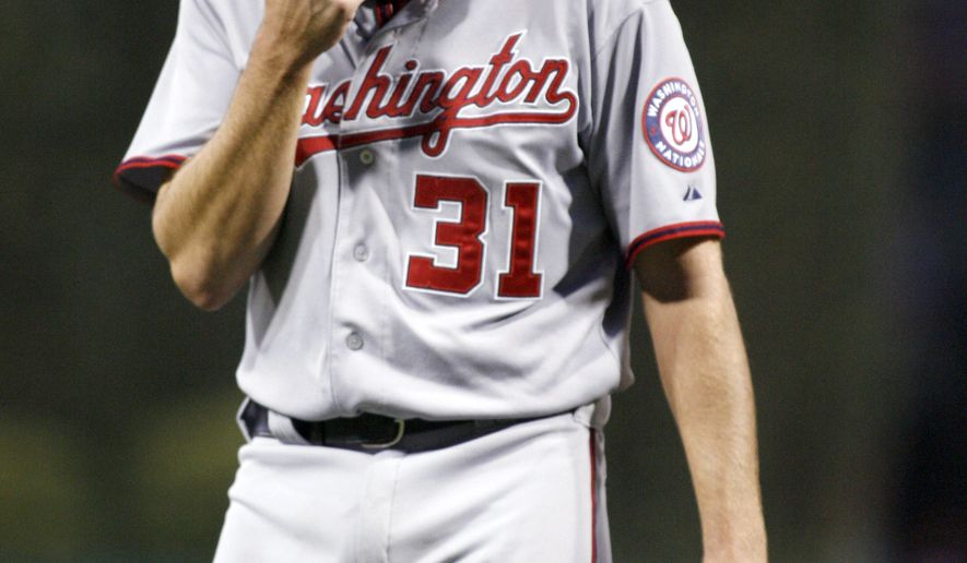 Washington Nationals' starting pitcher John Lannan leaves the baseball against the Philadelphia Phillies in the third inning on Thursday, May 5, 2011, in Philadelphia. (AP Photo/H. Rumph Jr)