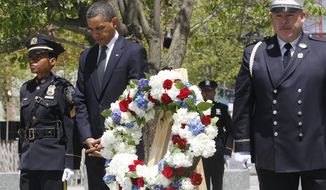 President Obama pauses Thursday after laying a wreath at the National Sept. 11 Memorial at Ground Zero in New York. (Associated Press)