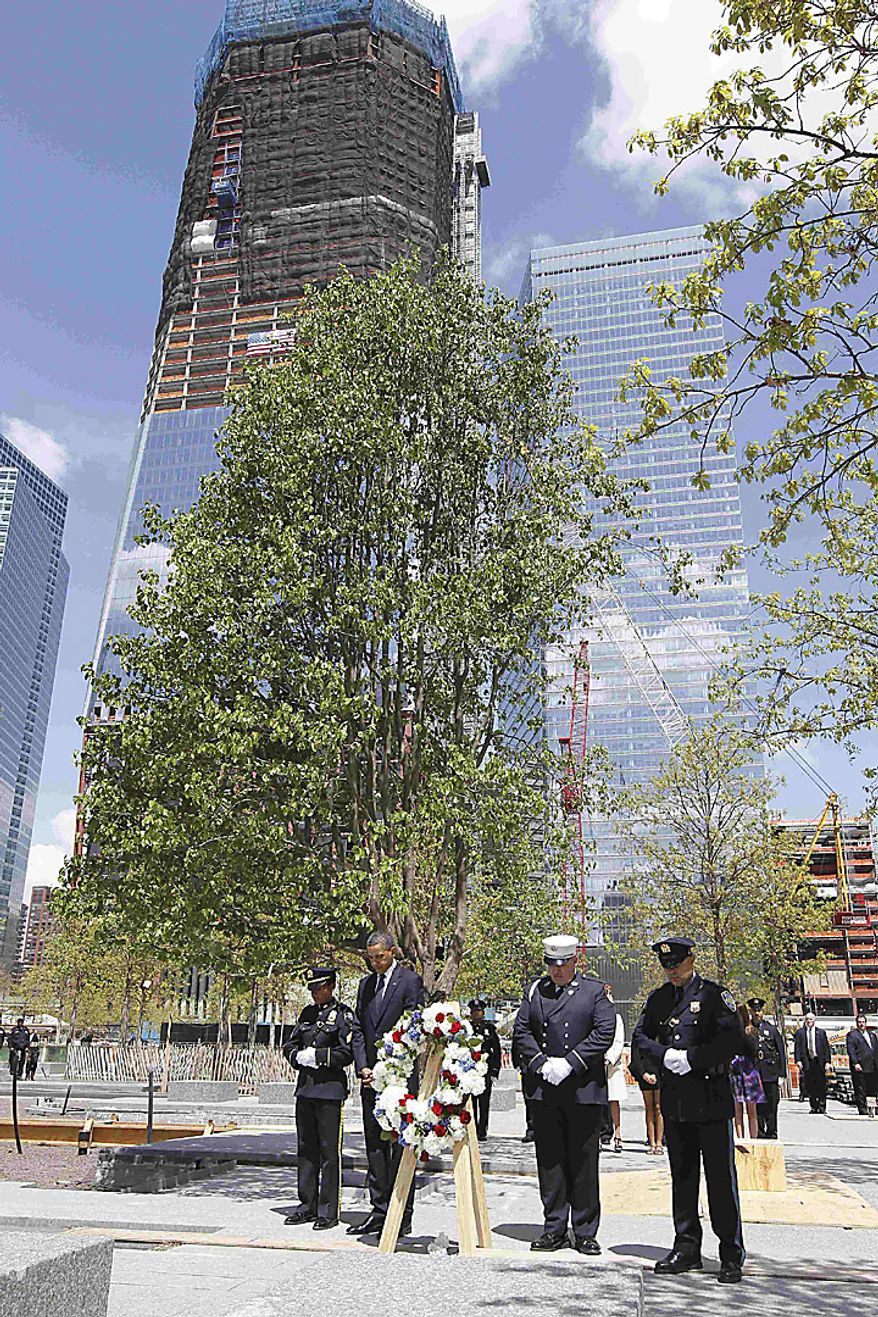President Barack Obama pauses after laying a wreath at the National Sept. 11 Memorial at Ground Zero in New York, Thursday, May 5, 2011. (AP Photo/Charles Dharapak)