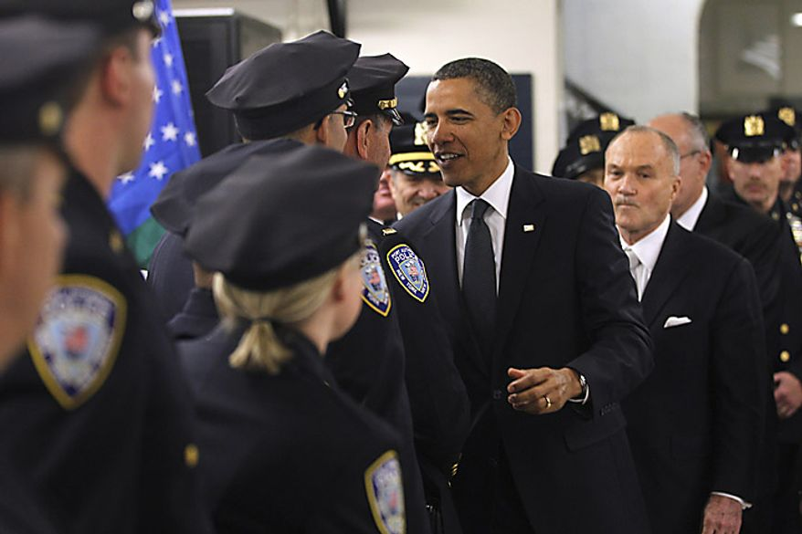 President Barack Obama, accompanied by Police Commissioner Raymond Kelly, and others, meets with police officers and first responders at the First Precinct before visiting the National Sept. 11 Memorial at Ground Zero in New York, Thursday, May 5, 2011. (AP Photo/Charles Dharapak)