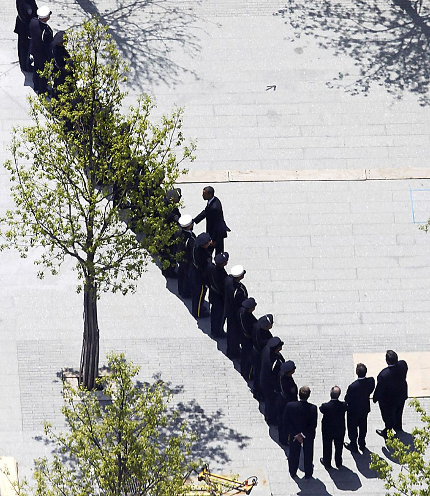 President Barack Obama, center,  shakes hands with first responders as he arrives for a wreath laying ceremony at the September 11 Memorial at the World Trade Center site in New York, Thursday, May 5, 2011. (AP Photo/Mark Lennihan)