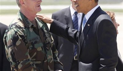 President Barack Obama talks with U.S. Navy Vice Admiral William H. McRaven, who as commander of Joint Special Operations Command (JSOC) had operational control of the mission to get Osama bin Laden, Friday, May 6, 2011, at Campbell Army Airfield in Fort Campbell, Ky. (AP Photo/Charles Dharapak)