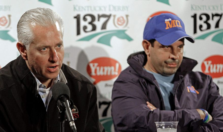 Uncle Mo owner Mike Repole, right, and trainer Todd Pletcher talk at a news conference at Churchill Downs Friday, May 6, 2011, in Louisville, Ky. Uncle Mo was scratched from the 137th Kentucky Derby. (AP Photo/Charlie Riedel)