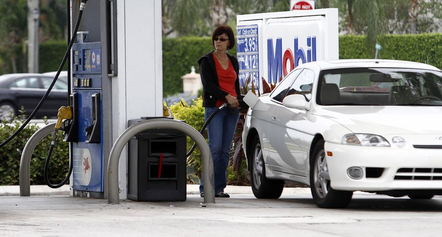 **FILE** A motorist fills her car at a Pembroke Pinses, Fla. Mobil gas station on May 5, 2011, with the price of regular gas near $4 a gallon. (Associated Press)