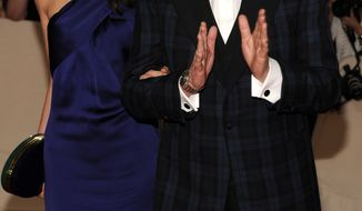 Recording artist Paul McCartney and Nancy Shevell arrive May 2 at the Metropolitan Museum of Art Costume Institute gala in New York. A publicist says McCartney is engaged to his girlfriend of nearly four years. (Associated Press)