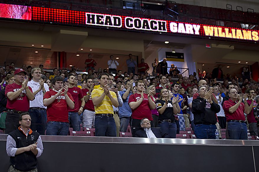 University of Maryland students and alumni give Coach Gary Williams a standing ovation during a press conference Friday, May 6, 2011 at the Comcast Center in College Park, Md., where the coach announced that, after a 33-year career, 22 of which have been at the University of Maryland, he would be re(...)