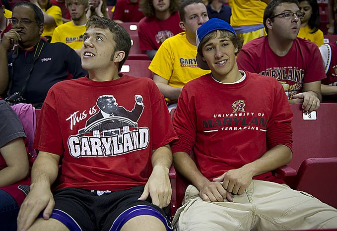 """University of Maryland students Michael Rossbach, left, a junior, and Andrew Pajak, a sophomore, donned their Maryland shirts to attend a press conference Friday, May 6, 2011 at the Comcast Center in College Park, Md., where Coach Gary Williams officially announced his retirement. """"It's heartbreakin(...)"""