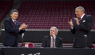 University of Maryland president Wallace Lowe, left, and Director of Athletics Kevin Anderson, right, applaud an emotional Gary Williams during a press conference Friday, May 6, 2011 at the Comcast Center in College Park, Md., where Williams officially announced his retirement as the school's basket(...)