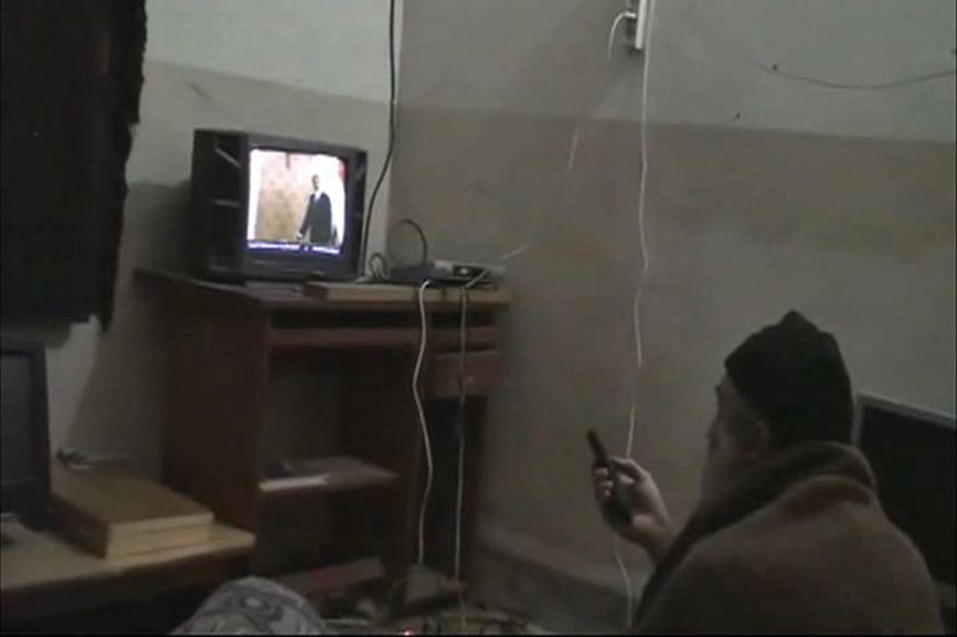 ** FILE ** In this undated image from video seized from the walled compound of al Qaeda leader Osama bin Laden in Abbottabad, Pakistan, and released on Saturday, May 7, 2011, by the U.S. Department of Defense, a man whom the American government identified as Osama bin Laden watches television with an image of President Obama on the screen. Bin Laden was killed by U.S. troops. (AP Photo/U.S. Department of Defense)