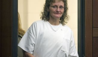 *** FILE ** In this file photo taken Tuesday, Jan. 18, 2011, in Ogden, Utah, Debra Brown enters Judge Michael DiReda's courtroom in Ogden, Utah. A Utah judge ruled Monday, May 2, 2011, that Brown, who is serving a life sentence after being convicted of murdering her employer 17 years ago, is innocent of the crime. (AP Photo/Al Hartmann, The Salt Lake Tribune, Pool, File)