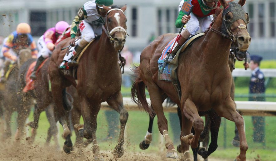 John Velazquez rides Animal Kingdom to victory during the 137th Kentucky Derby horse race at Churchill Downs Saturday, May 7, 2011, in Louisville, Ky. (AP Photo/Michael Conroy)