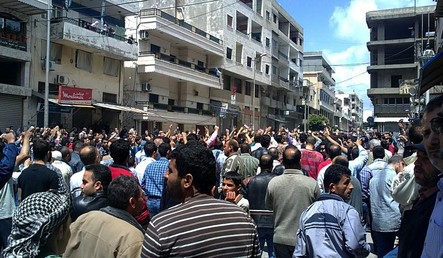 Syrian anti-government protesters shout slogans as they gather in the coastal town of Banias, Syria, on Friday, May 6, 2011, in this image taken by a citizen journalist with a cellphone camera and acquired by the AP. (AP Photo)