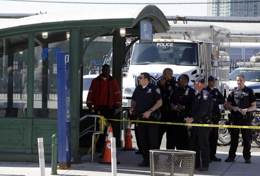 Emergency personnel gather near the entrance to the Port Authority Trans-Hudson (PATH) train station in Hoboken, N.J., on Sunday, May 8, 2011, after a train pulling into the station struck an abutment, causing minor injuries. (AP Photo/Seth Wenig)