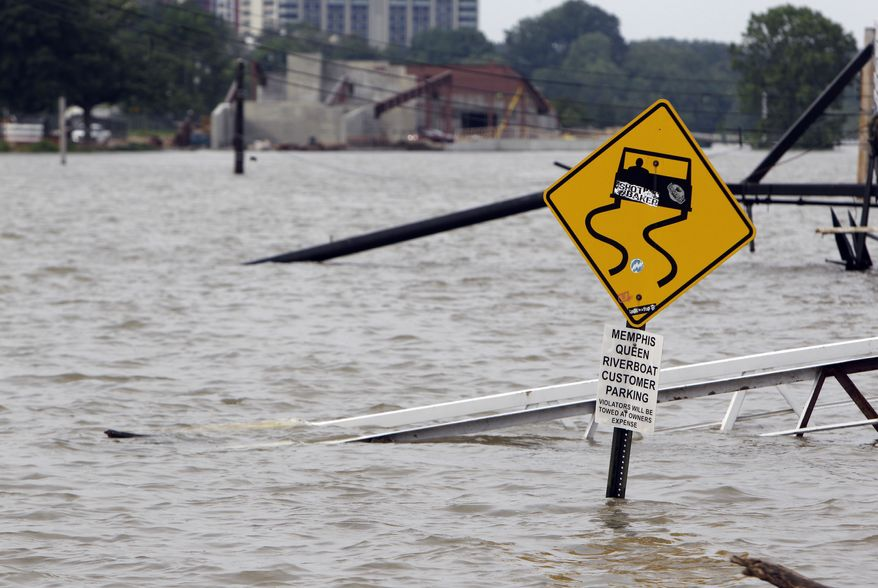 A ramp leading to the Memphis Queen riverboat and its parking area are surrounded by floodwater on Saturday, May 7, 2011, in Memphis, Tenn. Communities all along the banks of the Mississippi are keeping a close eye on the river's rise with the crest in Memphis not expected until Tuesday. (AP Photo/Jeff Roberson)