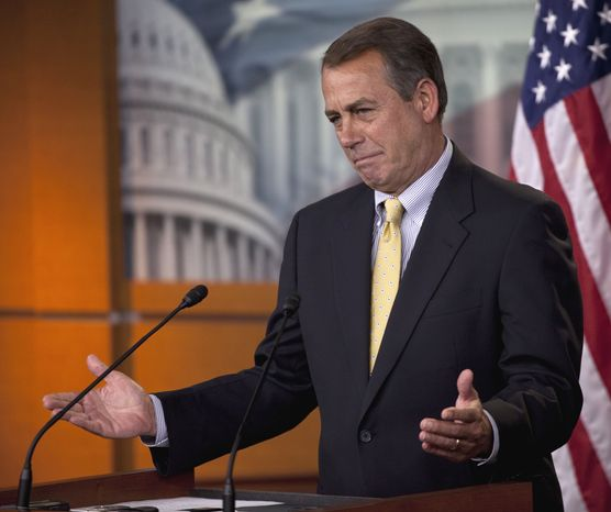 **FILE** House Speaker John Boehner of Ohio gestures May 5 during his weekly news briefing on Capitol Hill. (Associated Press)