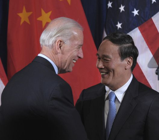 Vice President Joseph R. Biden Jr. greets Chinese Vice Premier Wang Qishan during the opening session of the U.S.-China Strategic and Economic Dialogue (S&ED) on Monday, May 9, 2011, at the Interior Department in Washington. (AP Photo/Susan Walsh)