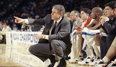 Associated Press Gary Williams, shown directing his Maryland players during the 1994 NCAA tournament, inherited a program in 1989 that would be punished by the NCAA for infractions committed under Bob Wade's watch.
