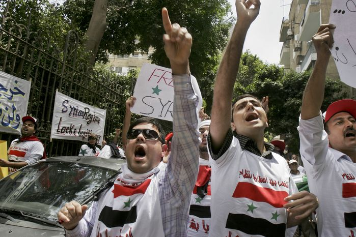 Demonstrators rally outside the Syrian Embassy in Cairo on Tuesday, May 10, 2011, to protest the crackdown on those who want to topple the regime of Syrian President Bashar Assad. (AP Photo/Mohammed Abu Zaid)